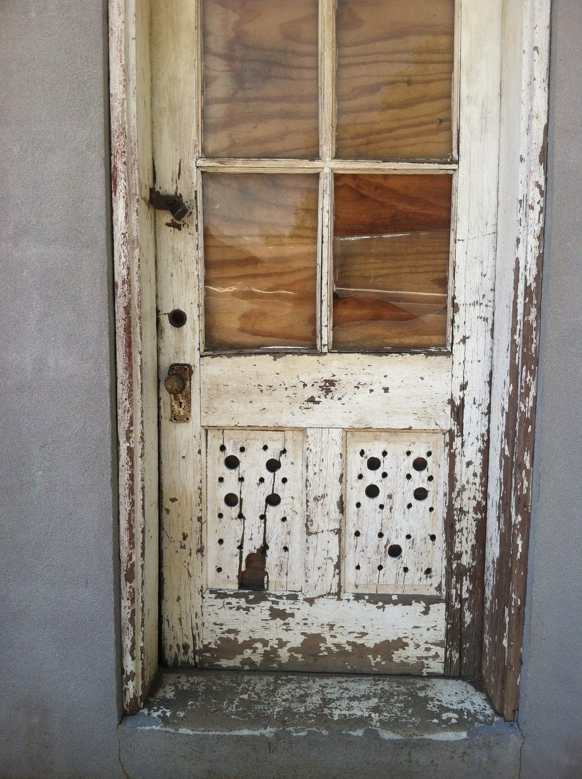 Page 2 photograph of a front wooden door from which front door couple was made rubansaba